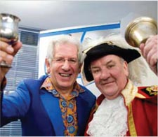 TV personality and guest speaker Adam Hart-Davis and a City of London town cryer.