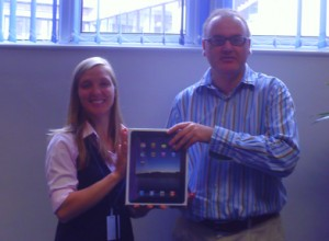 Laura Raschka, our Bristol Centre Manager presenting BE Ball Winner, Antony Portno, with his Apple iPad.