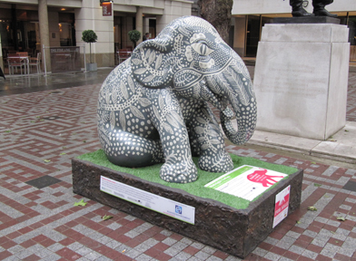 BE Offices Elephant stops for a rest in Bow Churchyard