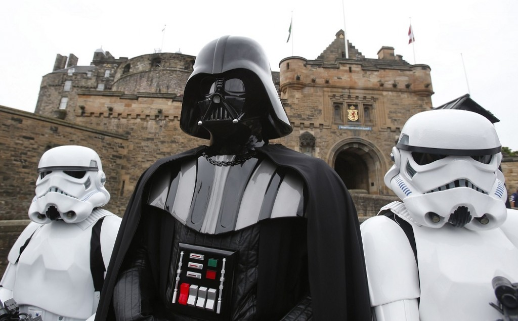 Star Wars character Darth Vader with Stormtroopers at Edinburgh Castle ahead of a screening of Star Wars Episode V The Empire Strikes Back (1980) at the Edinburgh International Film Festival.