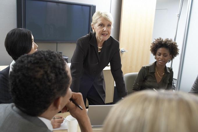 Senior businesswoman leading meeting
