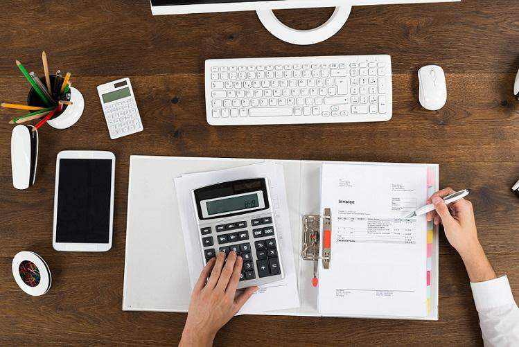 Businessperson Calculating Tax