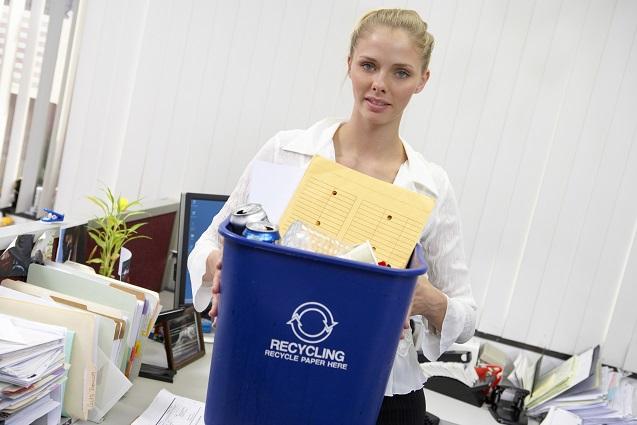 Businesswoman carrying recycle bin