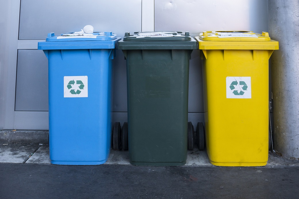 Three different recycling bins