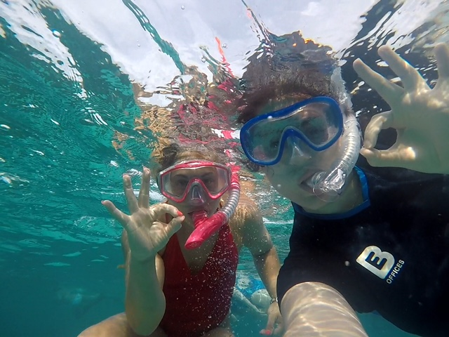 Our BE Offices volunteers snorkelling in Belize
