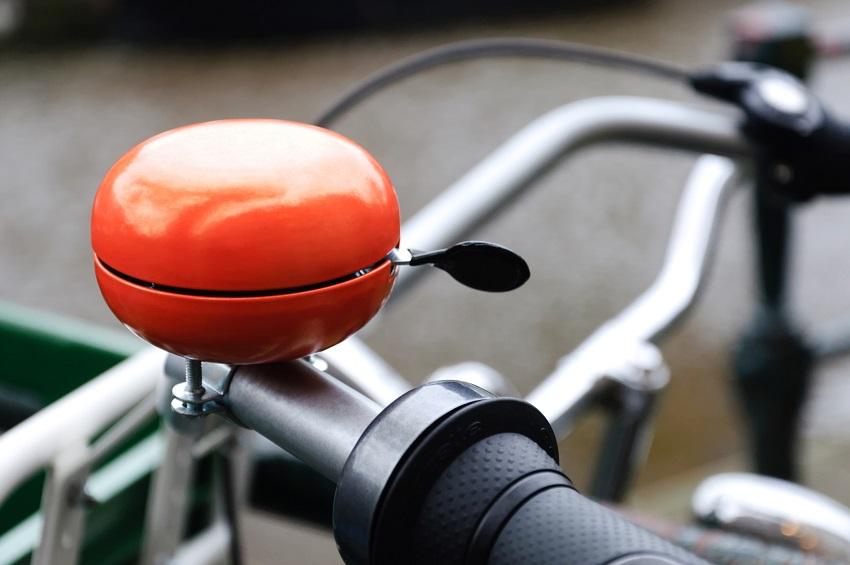 Bright orange bicycle bell. Shot was taken in Amsterdam, Holland.