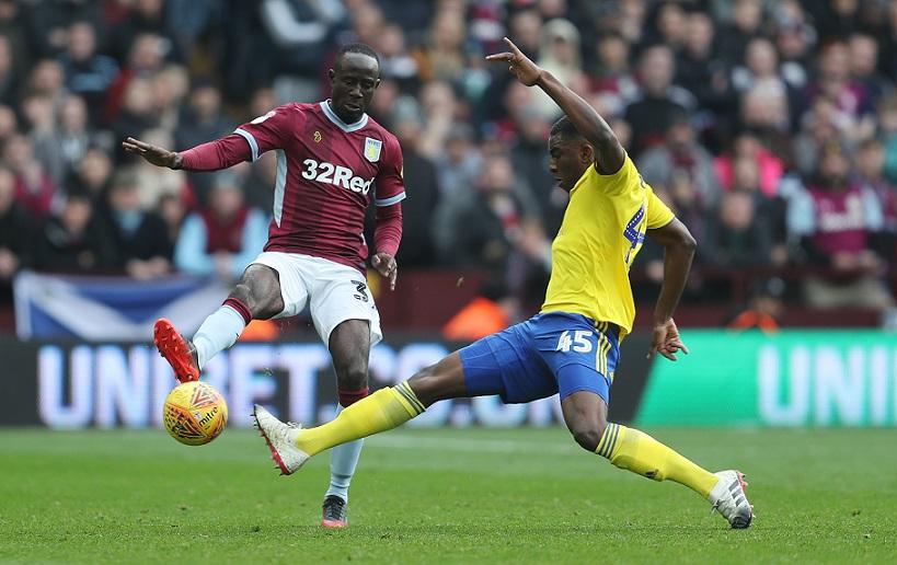 Aston Villa's Albert Adomah is tackled by Birmingham City's Wes Harding during the Sky Bet Championship match at Villa Park, Birmingham.